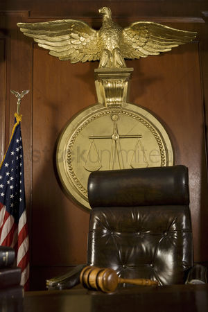 Flag : Gavel near judges chair in court room