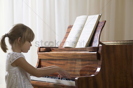 Ponytail : Girl  5-6  playing piano