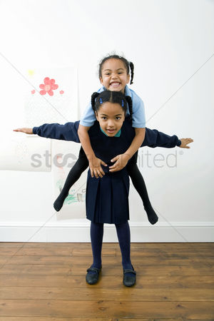 Strong : Girl carrying her sister on her back
