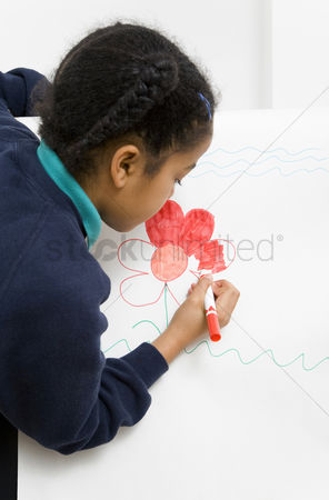 Pupil : Girl colouring picture on drawing board