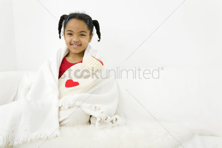 Relaxing : Girl hugging a hot water bottle