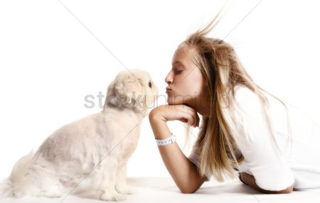 Enjoying : Girl kissing dog