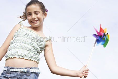 Day off : Girl playing with pinwheel