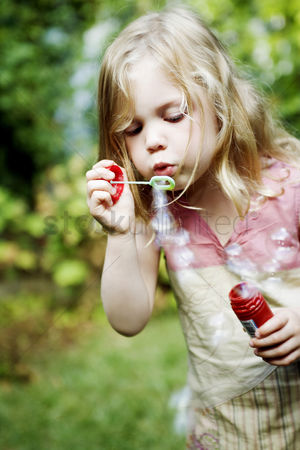 Blowing : Girl playing with soap bubbles