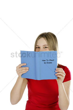 Careful : Girl reading on ways to cheat in exams