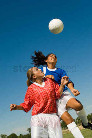 Pushing : Girls  13-17  attempting to head soccer ball