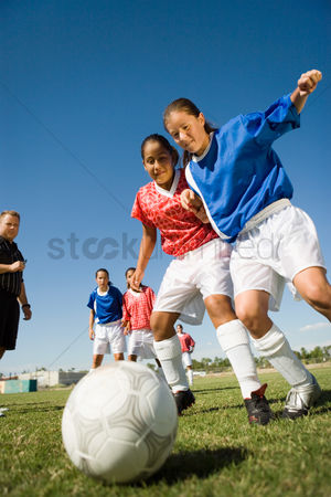 Pitch : Girls  13-17  playing soccer low angle view