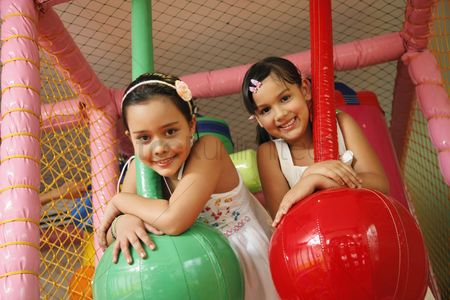 Rope : Girls posing on rope swing indoors