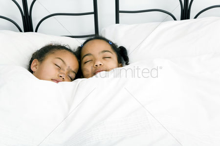 Rest : Girls sleeping together on the bed