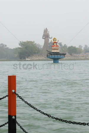 God : Goddess ganga statue in a river  ganges river  haridwar  uttarakhand  india