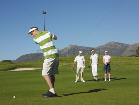Women group outside : Golfer teeing off