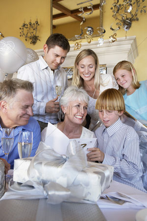 Birthday present : Grandmother smiling at party with whole family