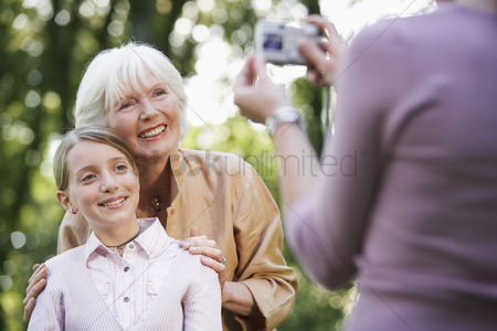 Women group outside : Grandmother with granddaughter posing for photograph
