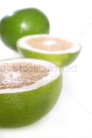 Spring : Green grapefruits on white background