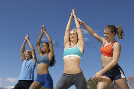Fitness : Group exercising with instructor in park