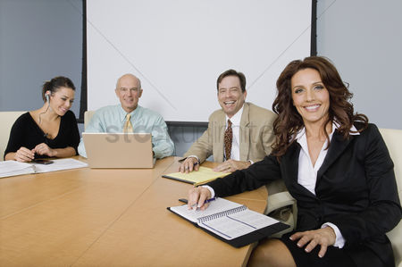 Appearance : Group of cheerful business people at a meeting
