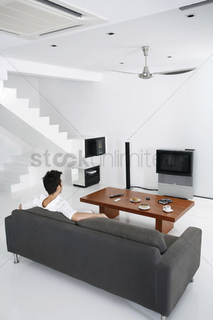 Tidy : Guy in a spacious living room