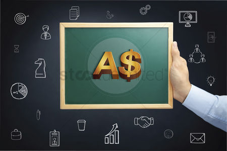 Animal : Hand holding blackboard with australian dollar and decline concept