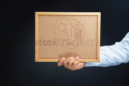 Applications : Hand holding board with property concept