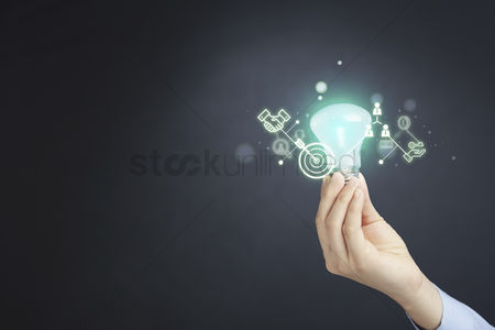 Grasp : Hand holding light bulb with business icons