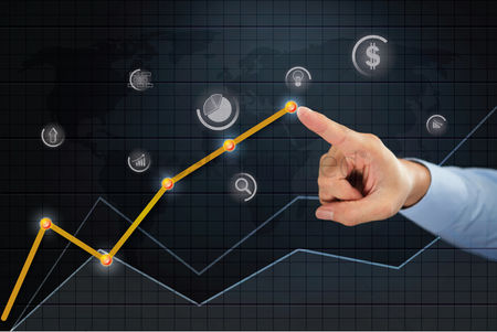 Media : Hand pointing towards business idea point on line chart concept