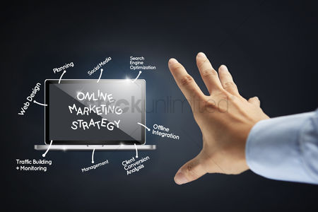 Notebook : Hand presenting an online marketing strategy diagram concept