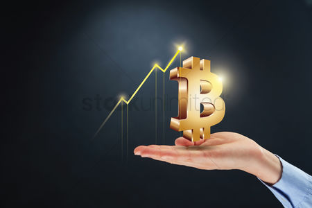 Symbol : Hand presenting bitcoin currency sign with profit concept