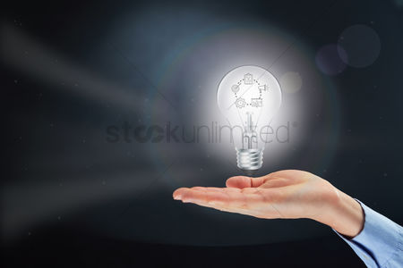 Thought : Hand presenting light bulb with business strategic planning concept