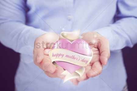 Heart shapes : Hand presenting mother s day greeting concept