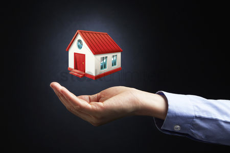 Media : Hand presenting real estate concept