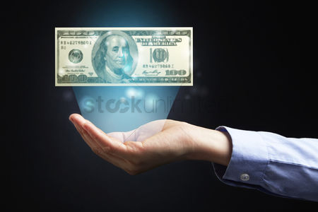 Dollar sign : Hand presenting us dollar banknote
