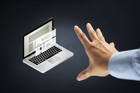 Devices : Hand reaching out towards laptop