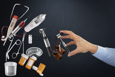 Medication : Hand reaching out towards medical tools