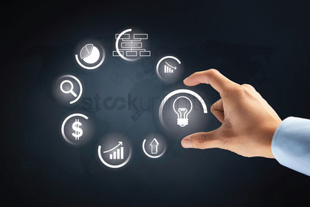 Selection : Hand with business ideas option on transparent board concept