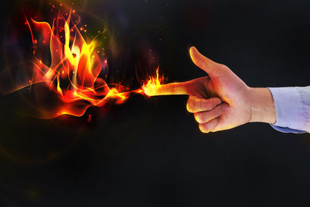 Points : Hand with gun gesture emitting flames