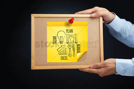 Cork board : Hands holding a board with a business strategy concept