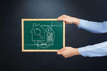 Magnifying glass : Hands holding a chalkboard with property concept