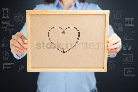 Handdrawn : Hands holding a cork board with heart sign