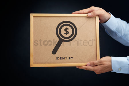 Cork board : Hands holding a cork board with identify concept