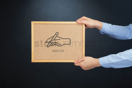 Cork board : Hands holding board with analyze concept