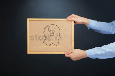 Cork board : Hands holding cork board with brainstorm concept