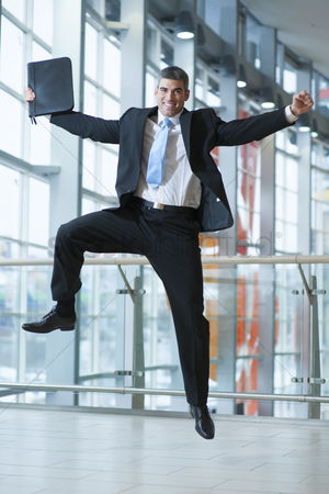 Excited : Happy businessman leaps into the air