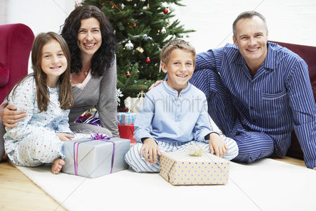 Relationships : Happy family in front of christmas tree portrait