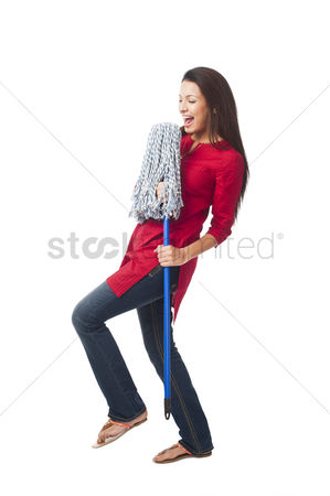 Housewife : Happy woman enjoying with a mop