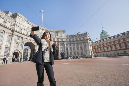 England : Happy woman taking self portrait against admiralty arch in london  england  uk