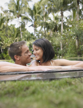 Gladness : Happy young couple in swimming pool
