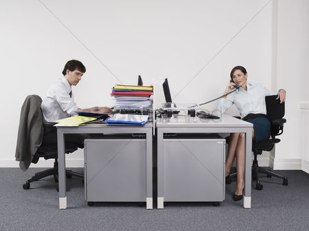 Supervisor : Hardworking man and relaxed woman in office