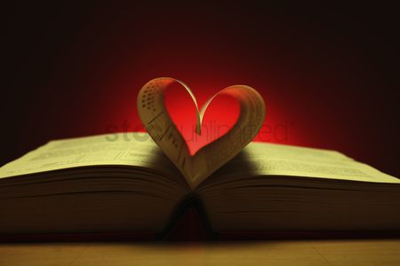 Creativity : Heart shape formed from pages in book