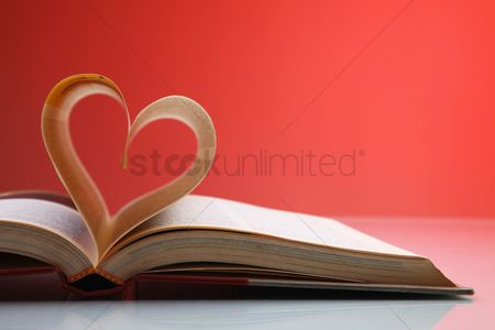Love : Heart shape formed from pages in book