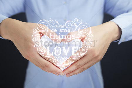 Conceptual : Heart shaped hands with quote